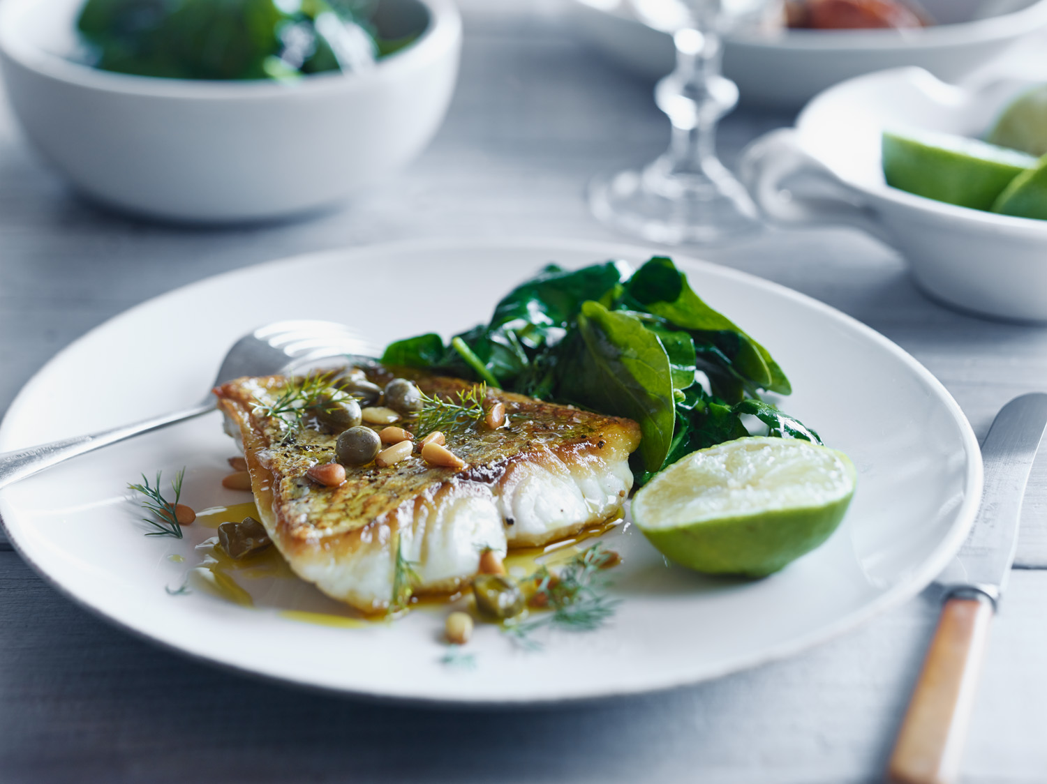 Crisp Skin Fish with Capers, Pine Nuts and Garlic Spinach