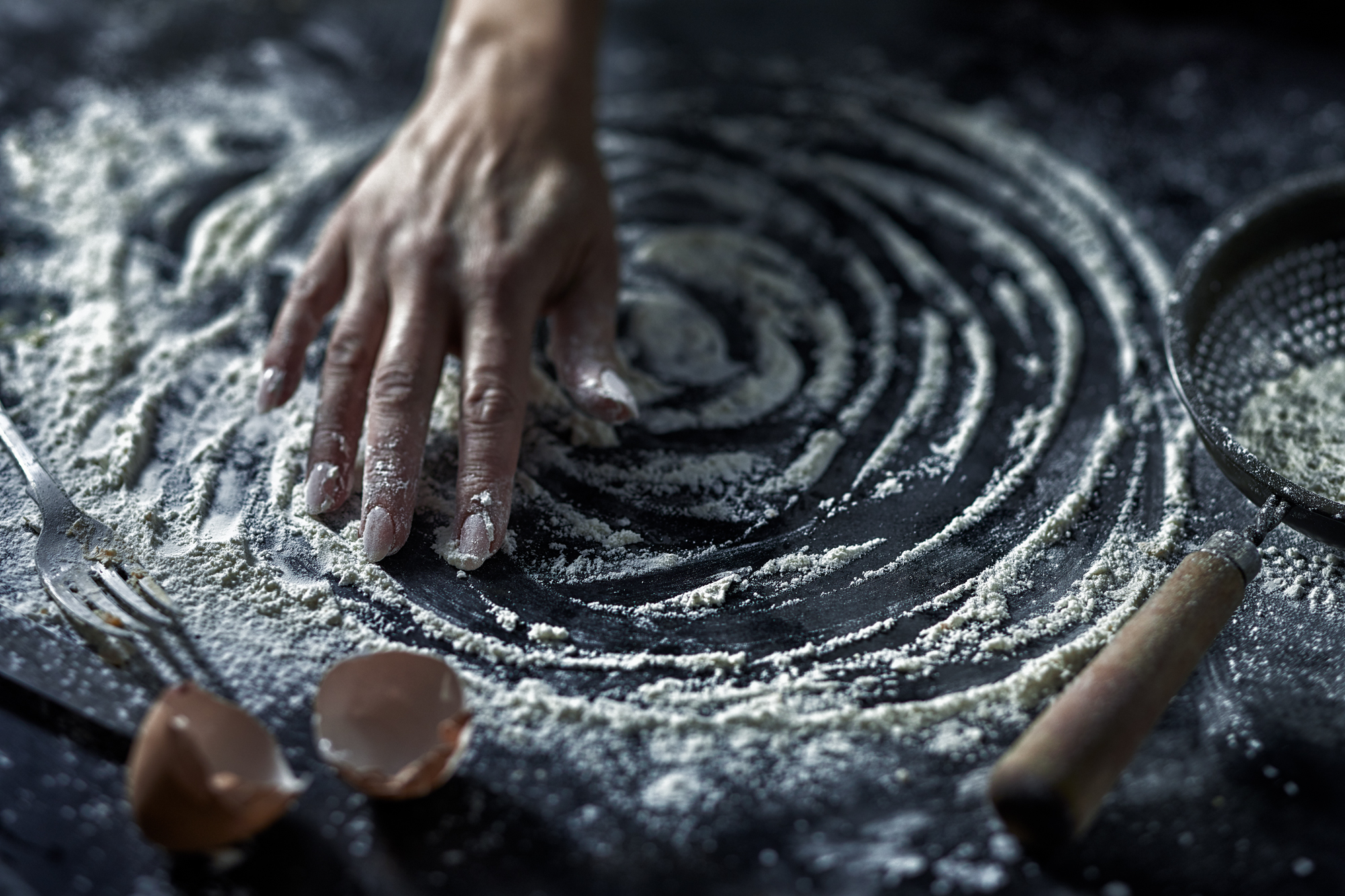 Foodcentric- Hand and flour on bench