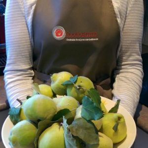 Foodcentric Apron - holding quinces