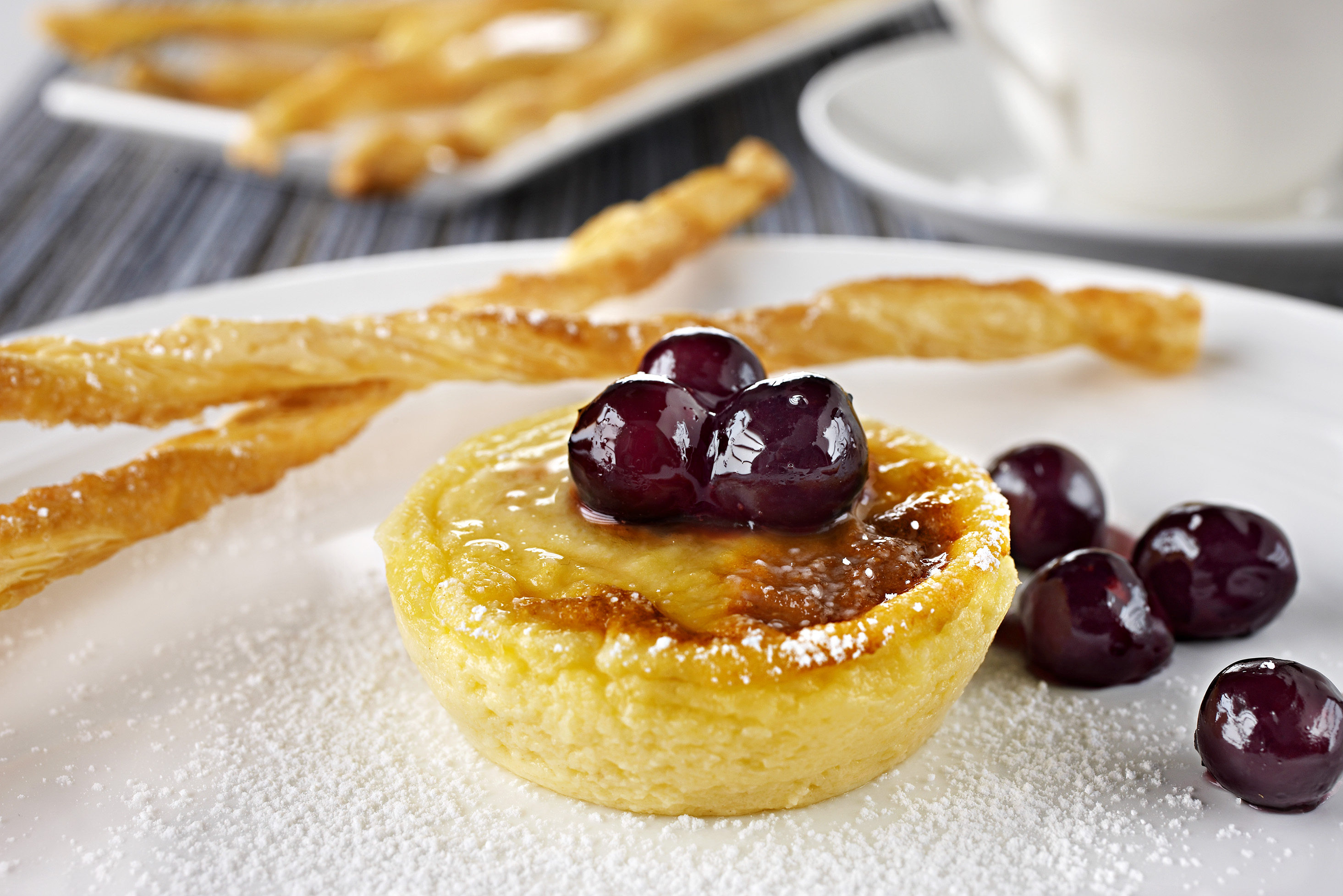 Little Cheesecakes with Blueberry Sauce and Sugared Twists